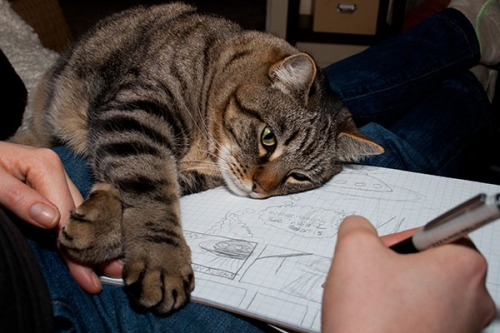 Otis supervising the creation of a drawing.